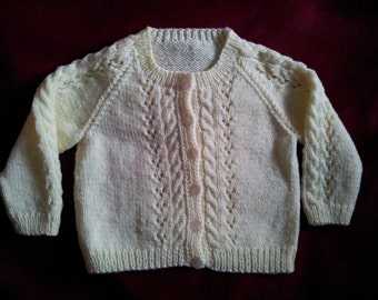 Hand knit childs cardigan in lemon, size 27 inch
