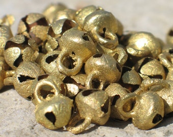 Tiny tiny Tibetan brass bells sold by the dozen, now 25% off