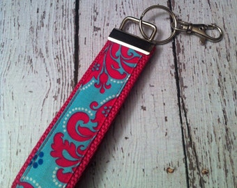 Hot pink and blue damask print key fob wristlet on pink cotton webbing with swivel lobster clasp