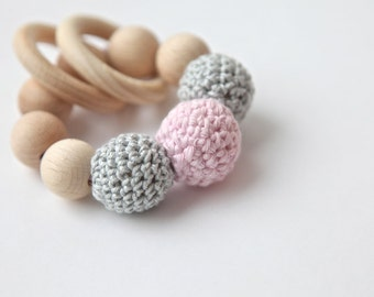 Teething toy with crochet wooden beads and 2 wooden rings. Light grey, pale pink wooden beads rattle.
