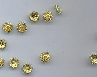 24 vintage Swarovski rhinestone rondelles - 8 x 3 mm chrysolite/gold plated
