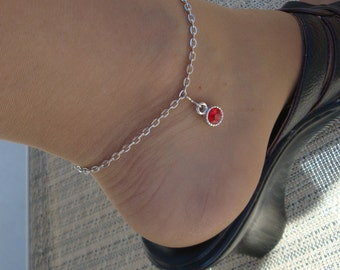 Gorgeous silvertone chain anklet with red glass accessory --adjustible.