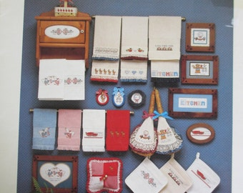 Cross Stitch Bordering on the edge paper pattern booklet.  Used
