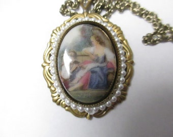 Vintage Cameo style Necklace. victorian lady with child on porcelain 24 inch antqiued gold tone no markings