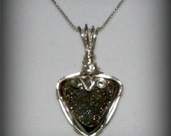 Beautifully wire-wrapped silver druzy using argentium silver....