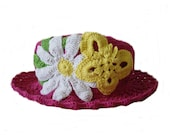 Fuchsia crocheted hat with a big  white flower and yellow butterfly