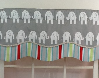 Elephant layered shaped valance in grey and white with gimp trim