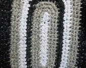 Oval Black Tan and White Crocheted Rag Rug