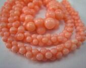 pink coral graduated bone bead 17.5 inch strand