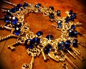 Jingling keys charm bracelet with cobalt blue Swarovski style glass faceted beads - ooak