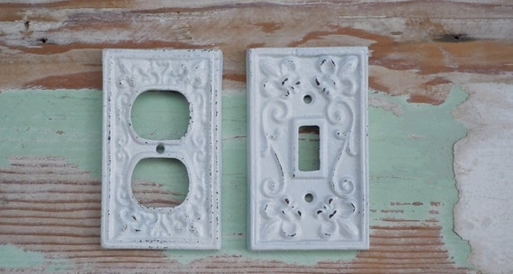 cast iron fleur de lis cover for light switch by