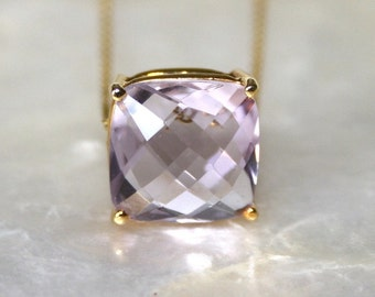 Pink amethyst and 18k gold pendant