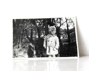 Vintage Photo: Young child in a forest