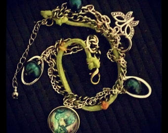 The Patterns Charm Bracelet with Butterfly on Green Suede strap