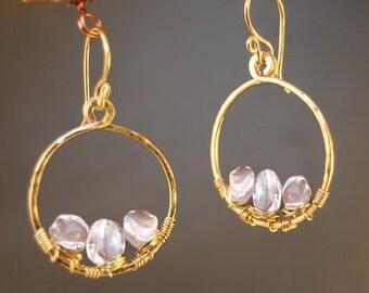 Ivory pearls wrapped inside a hammered hoop earrings Cosmopolitan 30