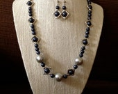 Handmade necklace and earring set, blue shell pearls with small metal frame beads