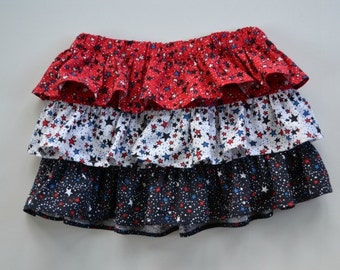 Layered skirt for toddler girl and girls.  Tiers of ruffles.  Red, white and blue stars.  Perfect for July 4, summer picnics.  1T - 4T.