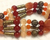 Bracelet w/Natural Orange and Red Jade beads, Natural Orange Aventurine and Mexican Opal.