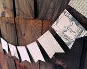 Repurposed vintage children's book paper bunting.