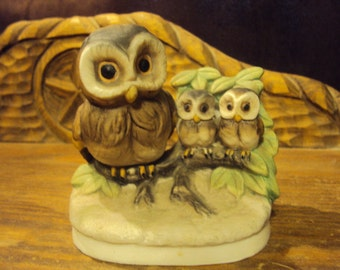 Mother with children owls