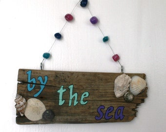 By the Sea Driftwood Art with colorful beads and shells peacelovedriftwood
