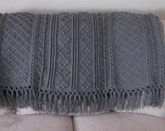 Gray Fishermans knit (aran) style throw.