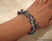 Glass bead bracelet hand crochet in blue and pearl colors