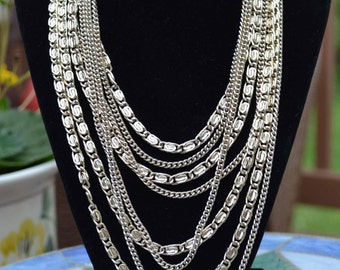 "8 Strand Multistrand Silver Tone Link Chain Necklace, 16"" shortest strand, Floral Clasp"