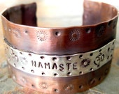 Namaste copper and sterling silver cuff