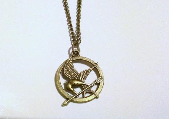 brass hunger mockingjay necklace by bunnysbeadsuk on