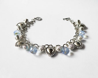 Metal chain bracelet handmade with sky blue crystal beads and metal heart pendants. ooak made in Italy