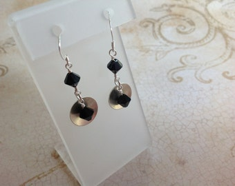 Sterling silver domed disc and crystal dangle earrings.