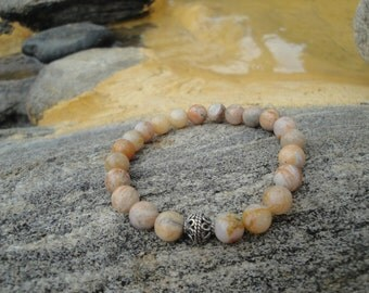 Bamboo Agate Stretch Bracelet with a Sterling Silver Accent Bead.