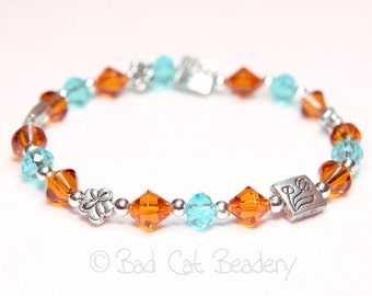 Southwestern Bead Stretch Bracelet Amber Gold-Brown Blue Crystal Silver Floral Beads