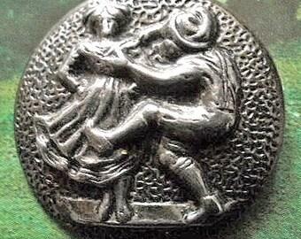 """Vintage metal button, a couple making merry, folk dancing, reverse """"GW Geschaft"""".  c1930's."""