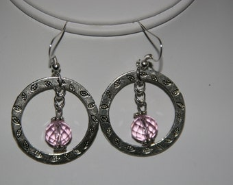 Large Ring Earrings and Pink Crystal.