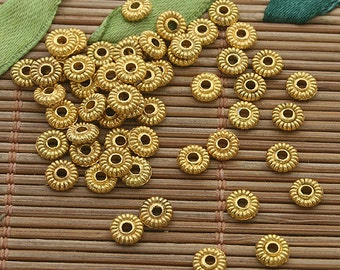 400pcs 5mm gold tone daisy spacer bead h3539