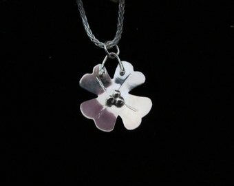 Sterling silver dogwood charm necklace