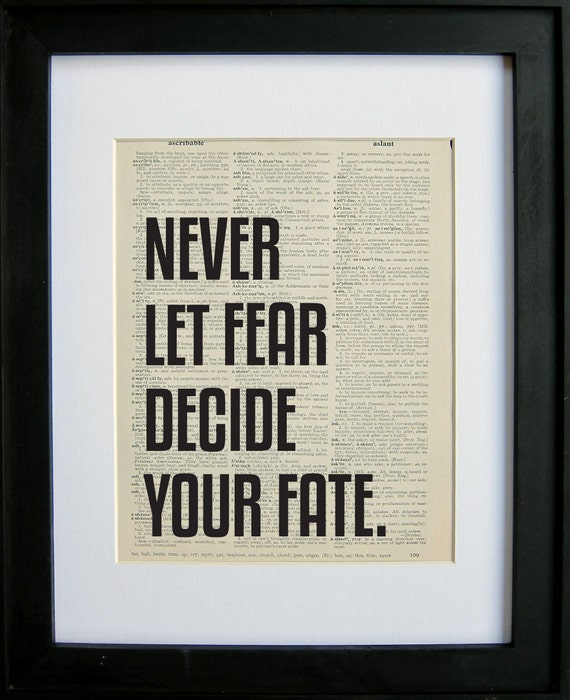 Never Let Fear Decide Your Fate printed on a page from an antique dictionary