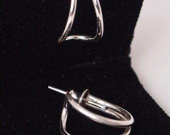 Small sterling silver wire hoops. Set on posts.