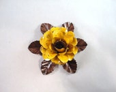 Medium Size Decorative Metal Hand Cut and Hand Painted Rustic Yellow Rose Mounted on a Bed of Metal Leaves.