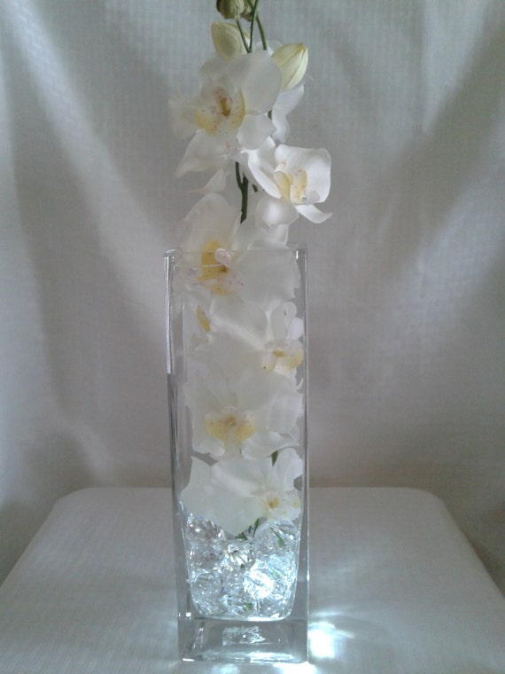 Pure white orchids in a 12 inch square vase perfect for