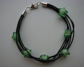 Leather bracelet with green acrylic stars