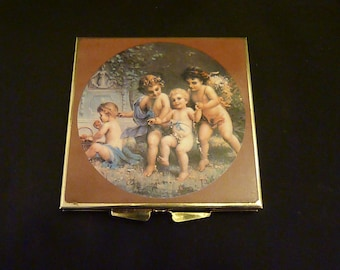 Vintage compact mirror with cherubs powder compact