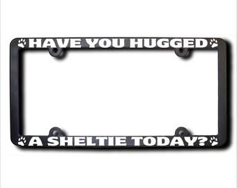 SHELTIE Have You Hugged A License Plate Frame (T) USA