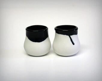 A pair of suction cups, porcelain, enamelled black