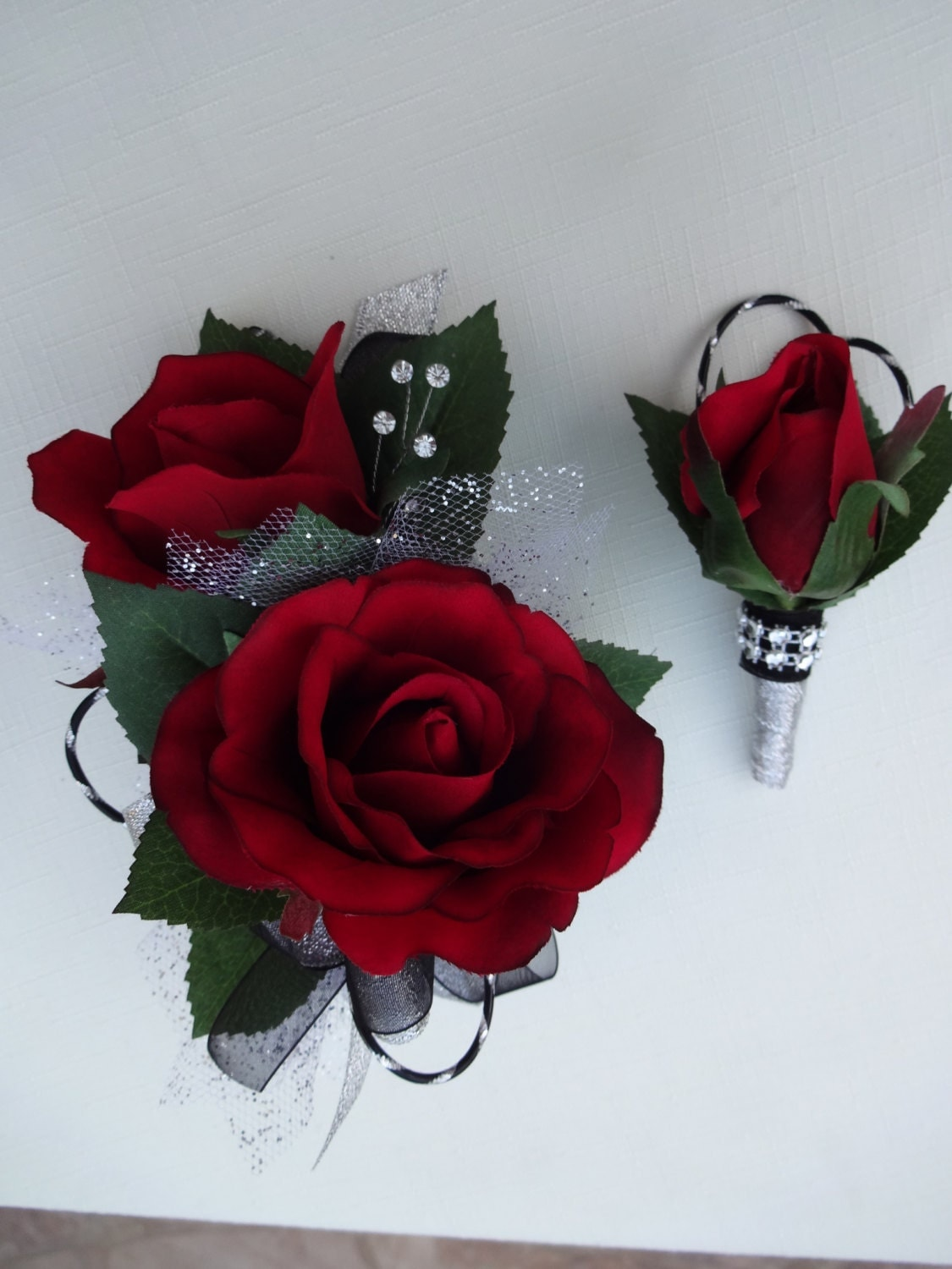 2 piece wrist corsage and boutonniere in red roses. Black Bedroom Furniture Sets. Home Design Ideas