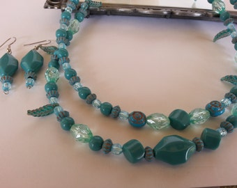 Assorted Turquoise 2 strand beaded necklace and earrings.