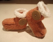 Hand knitted brown booties trimmed with Ugg button  range of sizes to fit 012 months