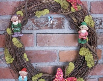 "Gnome wreath, 18"" contains fairy."
